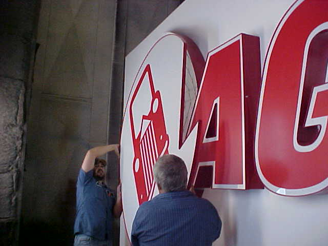 Assembling the letter and logo faces for the AGCO Automotive sign