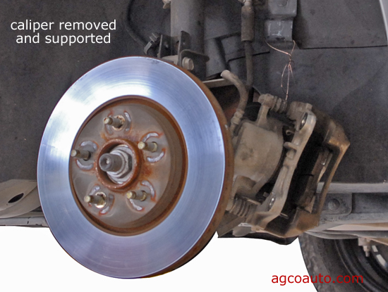 Support the brake caliper once remove to avoid damage to the hose
