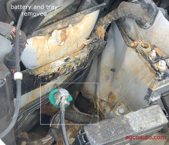 Leaking battery acid ate through body of vehicle