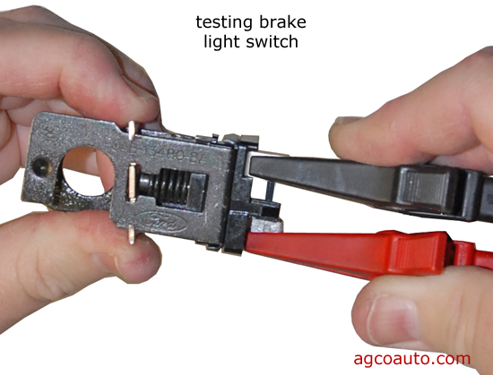 to test an analog brake-light switch for staying on, remove the switch and  test for continuity between the terminals  a wiring diagram and ohmmeter  are