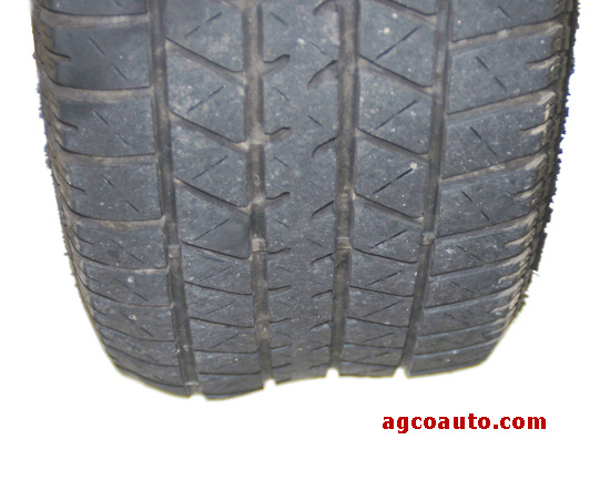 Tire tread with belt separation