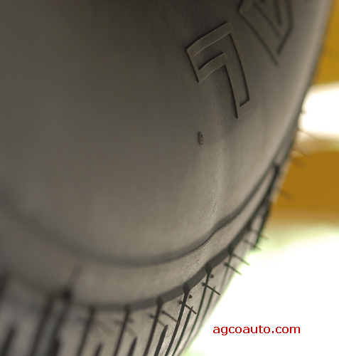 A tire showing an undulation in sidewall