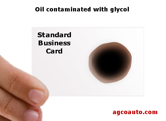 Glycol contaminated oil on a business card