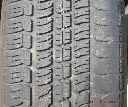 A tire showing wear from improper wheel alignment.