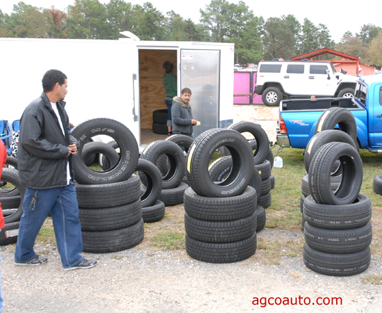 Used tires mixed in with cheap off brand tires at a flea market
